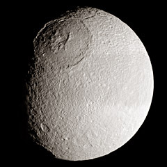 tethys moon of saturn the solar system on sea and sky